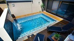 Sweet! Love the water feature. I can show you how to build this. Visit: www.custombuiltspas.com