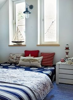 Nautical bedroom with sea shell and fish bedding plus lighthouse and sailboat decor