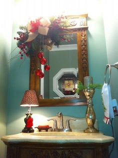 Christmas Bathroom Decor for Small Vanity Mirror with Ribbon and Pine Leaves with Glittered Red Baubles and Country Gold Mercury Glittered Candle Holder 20 Amazing Christmas Bathroom Decoration Ideas