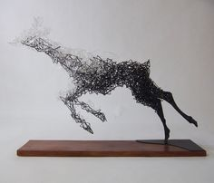 Tomohiro Inaba - 次の世界へ. Acrylic resin and steel wire,...