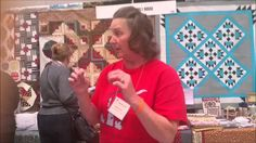 This is Karen Benke from the Little Red Quilt House, Medina Ohio, demonstrating the use of the Stripolgy Ruler by Creative Grids at the Original Sewing and Q...