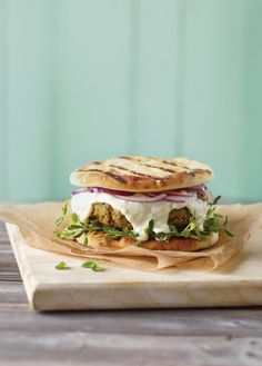 Vegetarian burger with creamy white cheese, chickpeas and vegetables