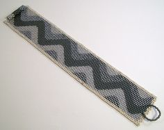 This is a wider version of my squiggle cuff pattern. I have added 4 columns of metallic silver Delicas. Peyote Patterns, Peyote Stitch, Brick Stitch, Loom Beading, Tie Clip, Gray, Beads, Columns, Silver