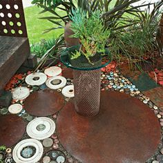 Broken doorknobs, salvaged steel discs, and a stove top burner are given new life in this quirky patio floor!