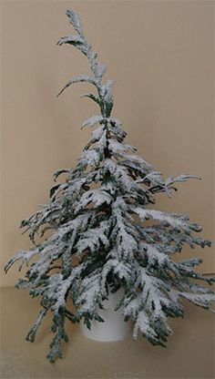 Miniature Christmas Tree Flocking Tutorial. In French with good photos to show each step. She used real cedar greenery and bicarbonate of soda, but the same thing could be made with plastic cedar greenery from craft picks.