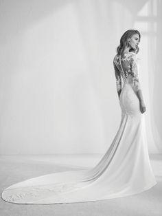 Vestido de novia encaje y manga larga