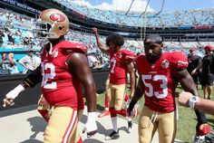 Colin Kaepernick Photos Photos - Colin Kaepernick #7 of the San Francisco 49ers walks to the locker room prior to their game against the Carolina Panthers at Bank of America Stadium on September 18, 2016 in Charlotte, North Carolina. - San Francisco 49ers v Carolina Panthers