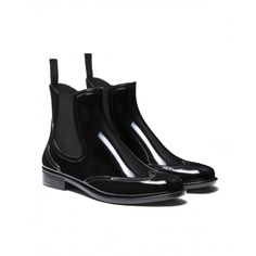 5b9e5c0d19b Glossy boots with low heel and stitching on the uppers. Matching elastic at  both sides