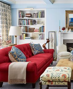 I don't generally like blue on walls, but this looks fresh, not cold. Love the red sofa.