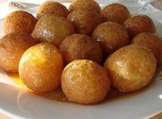 Loukoumades - Greek Honey Puffs - we get these at the International Street Fair near us, that is held every Labor Day weekend, and they are delicious. But who wants to wait a whole year for a treat you love? Greek Sweets, Greek Desserts, Greek Recipes, Indian Desserts, Greek Donuts, Mini Doughnuts, Honey Puffs, Greek Cooking, Greek Dishes