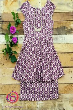 This Peplum dress is so versatile it can be worn from day to night. The print dress has a pretty pattern using burgundy and tan. Accessorize this fun dress with plenty of jewelry and heels for a girl's night out.
