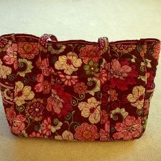 Beautiful floral print diaper bag The bag is huge and super versatile! Can be used a ton of ways (diaper bag, backpack, overnight bag). Zipper closer.  Perfect condition, no sign of wear! Vera Bradley Bags Baby Bags
