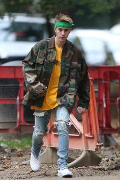 Justin Bieber wearing Fan Merchandise Purpose Tour Camo Shirt Jacket, Fan Merchandise Justin Bieber Purpose Security Tour T-Shirt, Fear of God Selvedge Denim Vintage Indigo Jeans, Vans Vault Classic Woven Slip On LX Sneakers