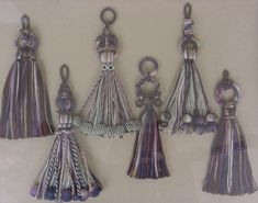 A set of tassel designs using woven ribbons - by Carol Blackburn