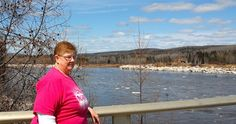 Lonna McBreairty stands on the St. John River bridge in Allagash a day after a ice jam let go. Twenty-four years ago, an ice jam destroyed the old bridge and left McBreairty and scores of residents stranded behind flood waters. Northern Maine, Higher Ground, 24 Years, The St, Scores, Bridge, Old Things, Ice, Water