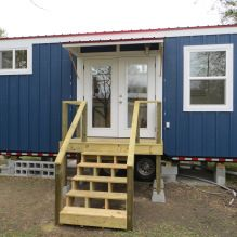 "Build it yourself! Plans are available. An 8×24 ft. ""climbing stairs"" home with abundant storage, a side entrance, open floor plan, shed roof, and a cool baseball theme! $46,000"