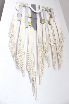The lucite rod size: 18 (45.8cm)W, 3/4 (2.0cm) diameter. It measures approximately 37 (94cm) from the top to the bottom of the longest fringe. Photo #5 shows the dimensions. Made from 100% cotton rope and organic cotton yarn. Decorated with 54 brass tubes.  If you have any questions, please feel free to mail me.  Please take a moment to read through our shops policies BEFORE purchasing :-)  For International buyers: Please contact me for shipping cost.  Thank you for visiting HIMO ART
