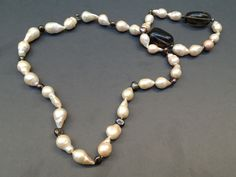 Necklace with fumée pearls  https://www.etsy.com/listing/203962831/necklace-with-fumee-pearls?ref=shop_home_active_3