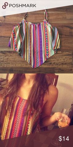 Colorful Crop top Great going out top, looks great with dark jeans or high waisted skirts. Fun colorful pattern with adjustable straps. Size small I would guess - Found at a consignment shop, no tags. Not Nasty Gal, tagged for exposure. Worn only a few times. Nasty Gal Tops