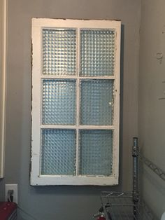 Old window to cover electrical panel