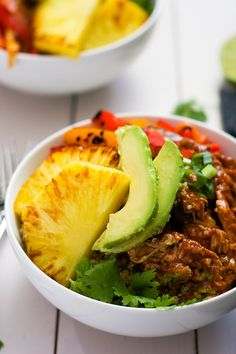 Slow Cooker Hawaiian Pork Burrito Bowls are a dinner saver as they cook all day in a homemade enchilada sauce then topped with sautéed peppers and juicy, seared pineapple! @thehitfiles