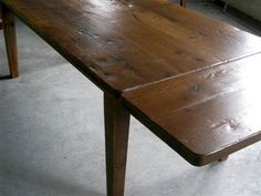 This very rustic barn wood farm table with straight legs is packed with character. Features wide board top, thick surface, made from 100% reclaimed wood.