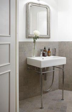 Bathroom has Tulikivi Atazul limestone tiles that match well with grey, mud and brownish colors. Tulikivi's media