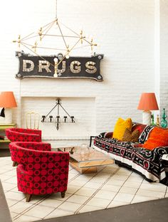 Eclectic and antique-filled living space with low coffee table
