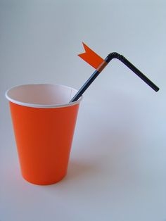 orange cups with black straw for Harley Davidson party