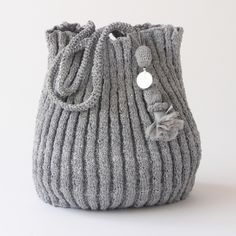 Made from recycled plastic bags. Designed by the French designer Domino Leserre and knitted by a womens co-operative in Morocco. Knitted Bags, Knitted Fabric, Recycled Plastic Bags, Knit Basket, Craft Accessories, Handmade Clothes, Knitting Designs, Bag Making, Fashion Bags