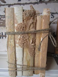 Wedding Centerpiece Unique Vintage Book Stack Jute Lace Shabby Chic Rustic Hipster. $24.00, via Etsy.