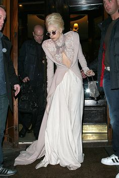 Lady Gaga looks polished in this keyhole gown in Paris.