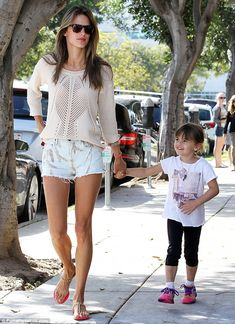 School on time: The 32-year-old Victoria's Secret model walked daughter Anja to school ahead of errands