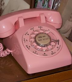 Pink Vintage rotary General Electric phone like we used to have. That's not my phone number lol.