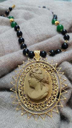 Item Description: Handcarved Lava Cameo pendant in 10K yellow gold filigree setting and onyx/jade bead necklace  Condition: Antique, 1800's  Dimensions: Approximately 3 x 2.5 inches