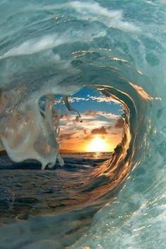 Sunset through wave