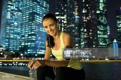 Stock Photo : Young woman with city in background after exercise