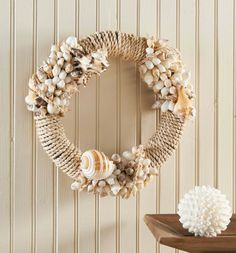 Shell Rope Wreath. Natural seashells in varied sizes and colors are clustered together by hand to accent our wreath. Each will be unique by nature.