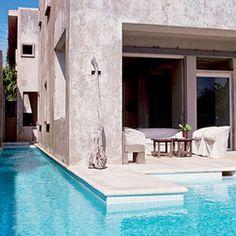 Concrete home. Beautiful pool.