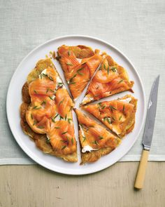 Arrange thin slices of russet potato in concentric circles in a cast-iron skillet and fry in clarified butter to make the crisp, golden galette. Topped with cream cheese and smoked salmon, it makes a spectacular addition to the brunch buffet. Smoked Salmon Appetizer, Smoked Salmon Recipes, Trout Recipes, Smoked Fish, Seafood Recipes, Brunch Recipes, Appetizer Recipes, Easter Recipes, Party Appetizers