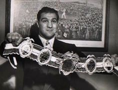 Rocky Marciano - One of the greatest boxers of all times. Heavyweight champion of the world and member of the International Boxing Hall Of Fame. The only world champion that was able to retire without a defeat. His boxing record is winning 43 by knockout Boxing Records, Boxing Images, World Boxing, Boxing History, Champions Of The World, Boxing Champions, People Of Interest, Mike Tyson, Sports Figures