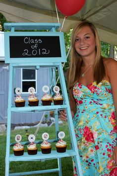An old wooden ladder spray painted and used as a cupcake stand.