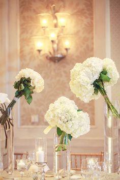 white flower wedding reception centerpiece idea; featured photographer: Binary Flips Photography
