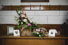 Pink flower arrangement and heart shaped frames - Image by Connor McCullough - A vintage inspired wedding in Northern Ireland with lace wedding dress, pink and green colour scheme and photographs by Connor McCullough wedding photographer