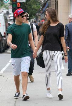 Louis Tomlinson strolls with girlfriend in Montreal.