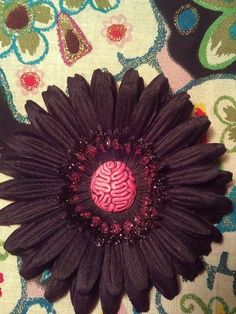 My mother would freak out if I wore this in my hair at my wedding -- that's a brain in the center!