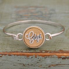 Two Tone Gigi Bangle Bracelet - Perfect Mother's Day gift for your loved ones! Find one for your Mimi, Mamaw, Grandma, Mom, Sister, Memaw, and MORE! Now $9.98!