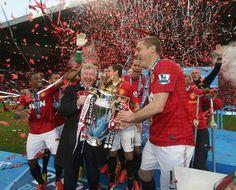 Sir Alex and Vidic hoist the cup