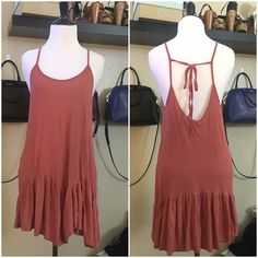 """Zara Trafaluc Shift Dress Zara Trafaluc Shift Dress »→ s »→ fits very loosely »→ length: 31"""" »→ gorgeous shift dress, ruffles on bottom hemline, tie & low back »→ preloved but in good condition »→ small hole on back of dress (pictured) not noticeable Zara Dresses Mini"""