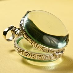 Glass Locket Round Bubble Hinge Picture Sterling Silver Pendant. $30.00, via Etsy.
